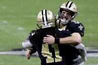New Orleans Saints quarterback Drew Brees, right, celebrates with running back Alvin Kamara (41) during the second half of an NFL divisional round playoff football game against the Tampa Bay Buccaneers, Sunday, Jan. 17, 2021, in New Orleans. (AP Photo/Butch Dill)