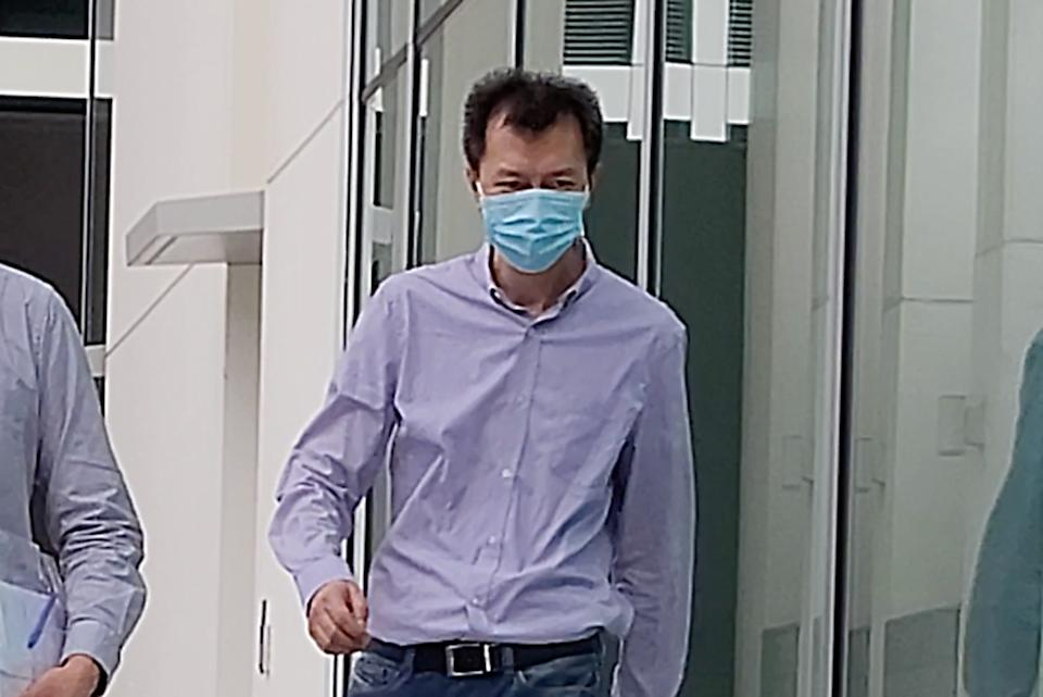 Bai Fan exiting the State Courts on Thursday (27 March). (PHOTO: Yahoo News Singapore/Wan Ting Koh)