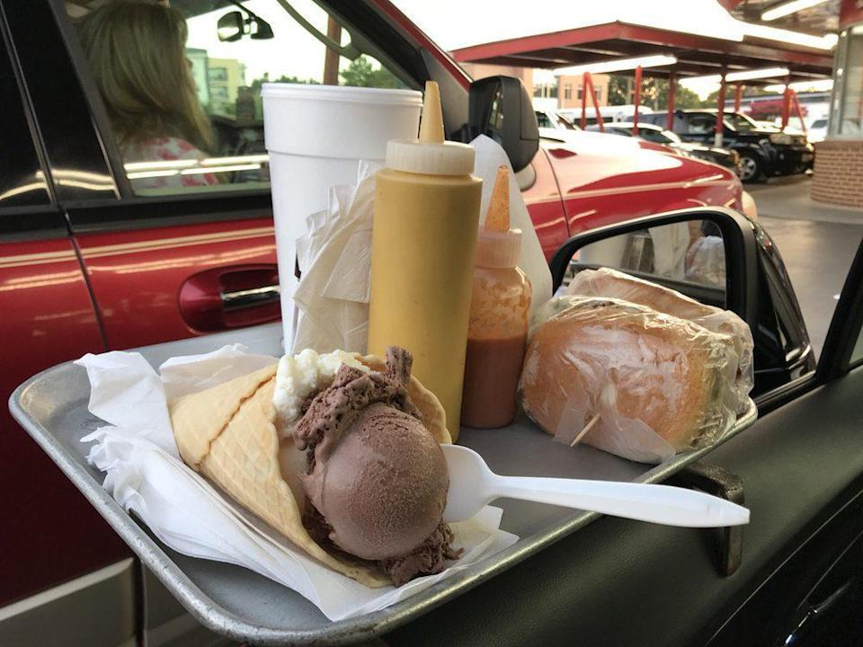"""<p>Every day is National Ice Cream Day at Doumar's Cones and Barbecue. The restaurant's founder, Abe Doumar, claims to have created the very first ice cream cone back in 1904, and this Virginia staple still uses what it claims is the world's first four-iron waffle machine, making this spot right up there with <a href=""""https://www.thedailymeal.com/eat/best-ice-cream-stand-every-state-gallery?referrer=yahoo&category=beauty_food&include_utm=1&utm_medium=referral&utm_source=yahoo&utm_campaign=feed"""" rel=""""nofollow noopener"""" target=""""_blank"""" data-ylk=""""slk:the best ice cream stands in America"""" class=""""link rapid-noclick-resp"""">the best ice cream stands in America</a>. </p>"""