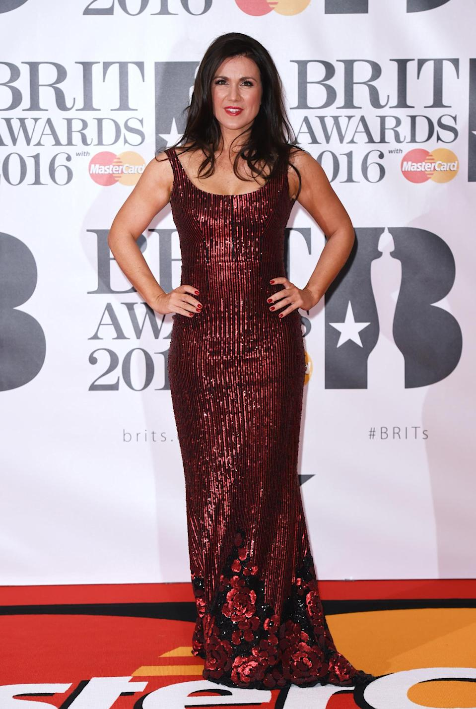 <p>Looking a lot more red carpet than a lot of the other celebs, the TV presenter opted for a striking sequin-covered gown. <i>[Photo: Rex]</i></p>