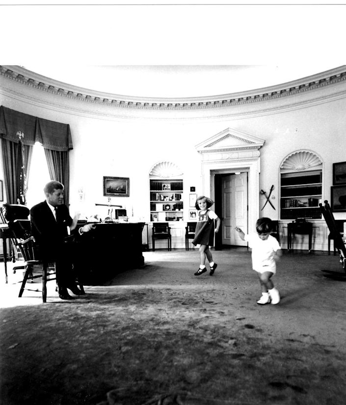 <p>Most of us will never step foot in the White House, but Caroline and John F. Kennedy Jr. felt right at home in the West Wing. During their father's term as President, they casually twirled around the most important office in the country during playtime. </p>