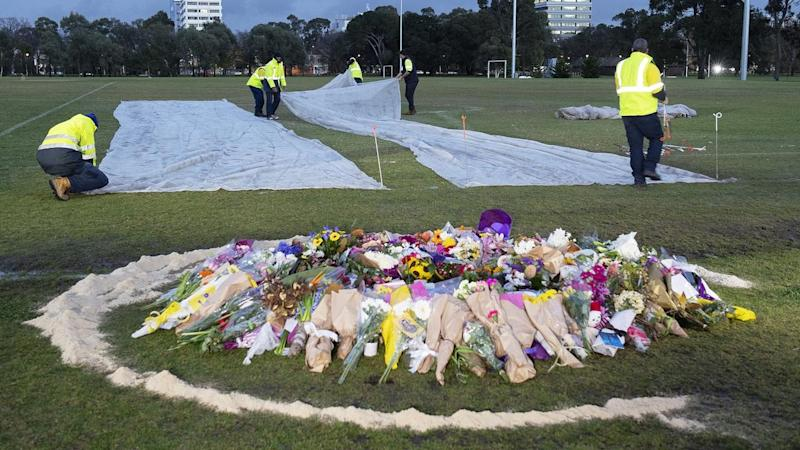 Council workers cover up graffiti painted at the memorial site of Melbourne comedian Eurydice Dixon