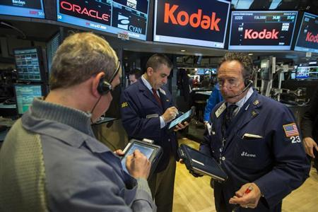 Traders work on the floor of the New York Stock Exchange in the Manhattan borough of New York