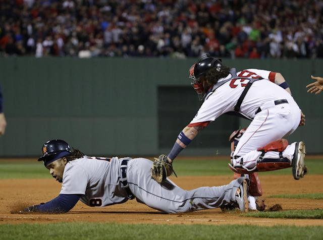 Boston Red Sox catcher Jarrod Saltalamacchia (39) tags out Detroit Tigers' Prince Fielder, left, in the sixth inning during Game 6 of the American League baseball championship series on Saturday, Oct. 19, 2013, in Boston. (AP Photo/Matt Slocum)