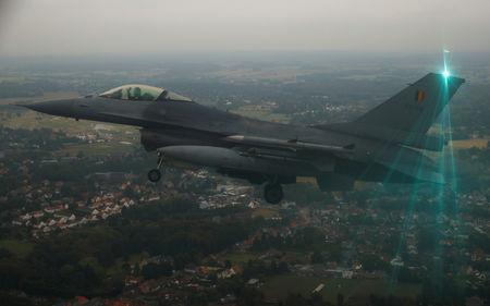 A Belgian F16 fighter plane demonstrates the interception of an air force transport plane as they fly over Belgium, September 12, 2018 as part of NATO drills.   REUTERS/Francois Lenoir