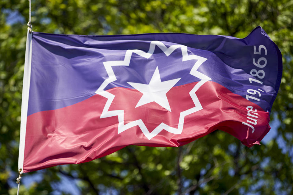 The Juneteenth flag, commemorating the day that slavery ended in the U.S., flies in Omaha, Neb., Wednesday, June 17, 2020. (AP Photo/Nati Harnik)
