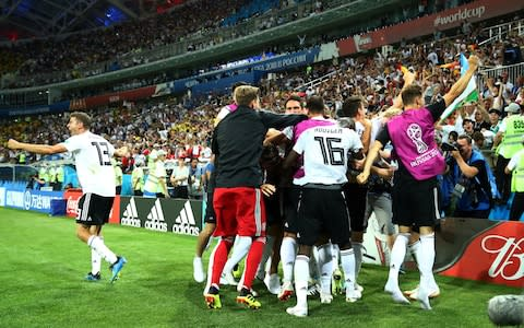 Wild celebrations are sparked by Toni Kroos' winning goal - Credit: REUTERS