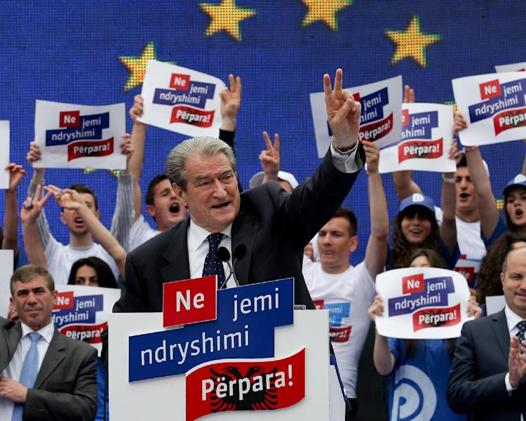 Albania's Conservative Prime Minister Sali Berisha, 68, who is seeking a third term in office, speaks at a rally in Tirana, Tuesday, June 18, 2013. The general election taking place Sunday, June 23, 2013 is considered a test for the Balkan country to shed its post-Communist legacy of troubled popular votes, as it seeks closer ties and eventual membership in the European Union. Conservative Sali Berisha, is seeking a third term and will speak at his Democratic Party's main election rally Friday in the capital Tirana. (AP Photo/Hektor Pustina)