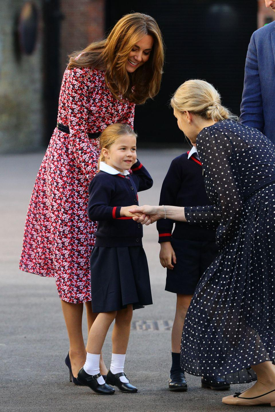 "<p>For Princess Charlotte's first day of school,<a href=""https://www.townandcountrymag.com/style/fashion-trends/a28901465/kate-middleton-pink-dress-princess-charlotte-first-day-of-school-photo/"" rel=""nofollow noopener"" target=""_blank"" data-ylk=""slk:the Duchess of Cambridge chose a lovely pink floral dress, which she paired with pointy toe pumps and a black, waist-defining belt"" class=""link rapid-noclick-resp""> the Duchess of Cambridge chose a lovely pink floral dress, which she paired with pointy toe pumps and a black, waist-defining belt</a>. </p>"