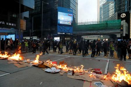 Protestors leave after lighting fire on a road during a rally in Hong Kong