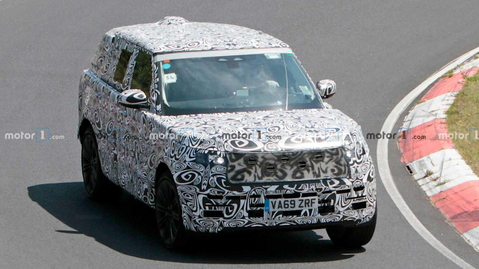 """<p>Land Rover is developing a new <a href=""""https://www.motor1.com/land-rover/range-rover/"""" rel=""""nofollow noopener"""" target=""""_blank"""" data-ylk=""""slk:Range Rover"""" class=""""link rapid-noclick-resp"""">Range Rover</a>. It maintains the model's familiar, boxy exterior styling.</p> <p><a href=""""https://www.motor1.com/news/435364/2022-range-rover-spy-photos/"""" rel=""""nofollow noopener"""" target=""""_blank"""" data-ylk=""""slk:Next-Gen Range Rover Spied Putting In The Work On Nürburgring"""" class=""""link rapid-noclick-resp"""">Next-Gen Range Rover Spied Putting In The Work On Nürburgring</a></p> <br><a href=""""https://www.motor1.com/news/423270/land-rover-range-rover-spied/"""" rel=""""nofollow noopener"""" target=""""_blank"""" data-ylk=""""slk:Next-Gen Land Rover Range Rover Spied Posing With Defender"""" class=""""link rapid-noclick-resp"""">Next-Gen Land Rover Range Rover Spied Posing With Defender</a><br><a href=""""https://www.motor1.com/news/399059/2022-range-rover-sport-spy/"""" rel=""""nofollow noopener"""" target=""""_blank"""" data-ylk=""""slk:2022 Range Rover Caught In A Winter Wonderland"""" class=""""link rapid-noclick-resp"""">2022 Range Rover Caught In A Winter Wonderland</a><br>"""