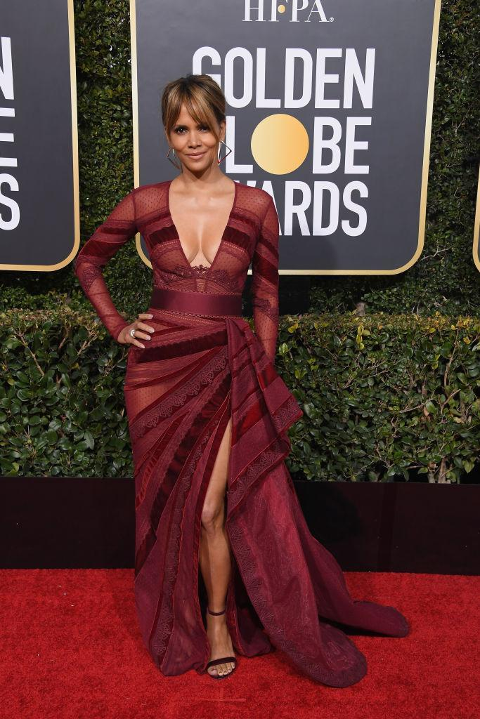 <p>Are you at all surprised to see presenter Halle Berry looking lovely in a wine-colored gown? Neither were we. (Photo: Getty Images) </p>