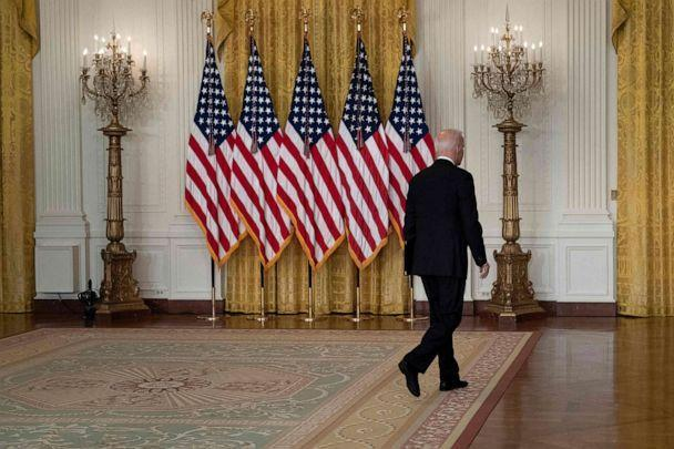 PHOTO: President Joe Biden leaves after speaking about the Taliban's takeover of Afghanistan from the East Room of the White House, Aug. 16, 2021, in Washington. (Brendan Smialowski/AFP via Getty Images)