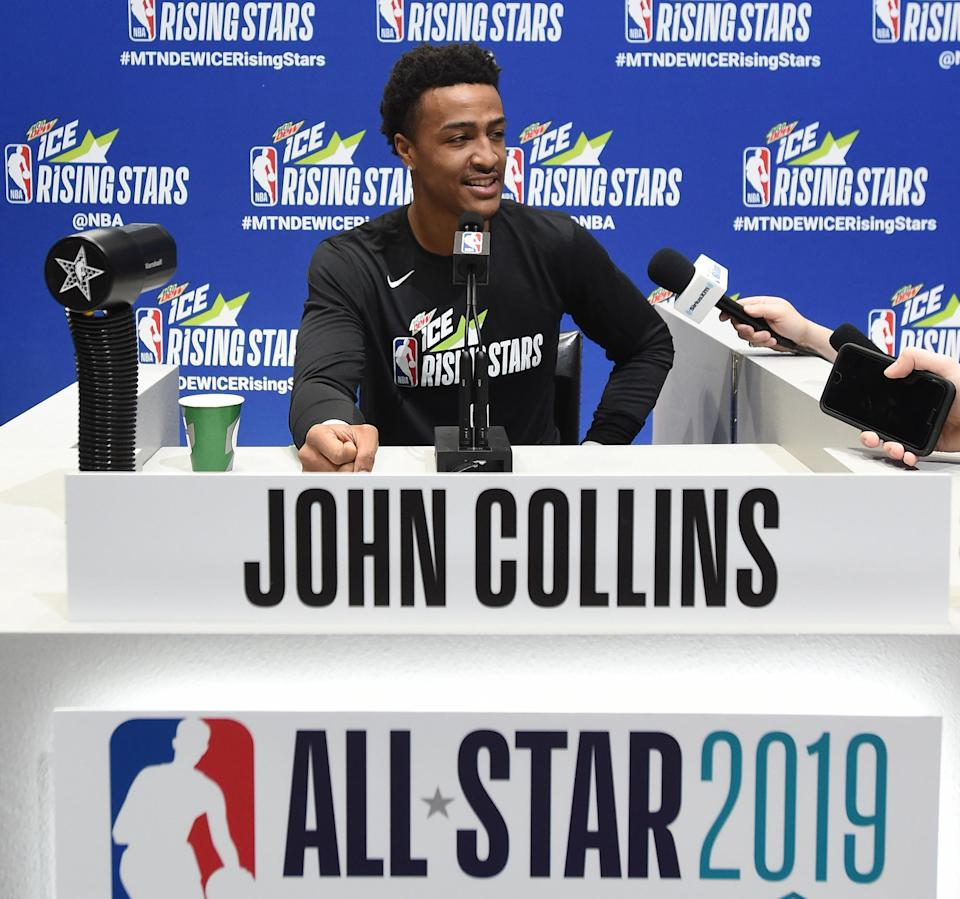 John Collins talks to the media during the 2019 NBA All-Star Rising Stars practice and media availability on Friday in Charlotte, North Carolina. (Photo by Juan Ocampo/NBAE via Getty Images)