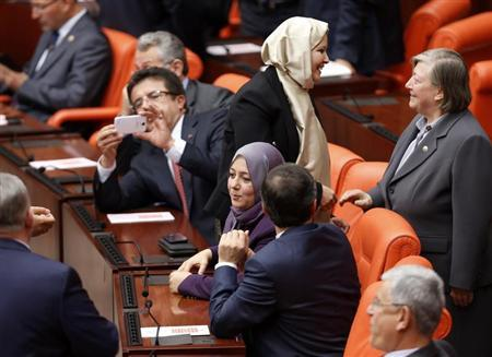 Turkey's ruling AKP lawmakers Nurcan Dalbudak and Sevde Beyazit Kacar attend the general assembly wearing their headscarves at the Turkish Parliament in Ankara