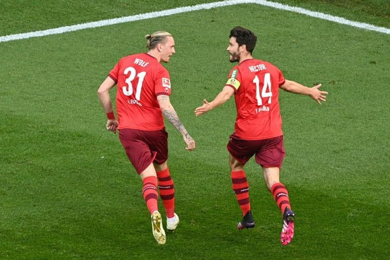 Cologne captain Jonas Hector (R) celebrates scoring the winning goal at home to RB Leipzig