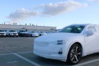 Polestar electric vehicle for export is seen in front of Volvo sport utility vehicles at a Geely plant in Taizhou