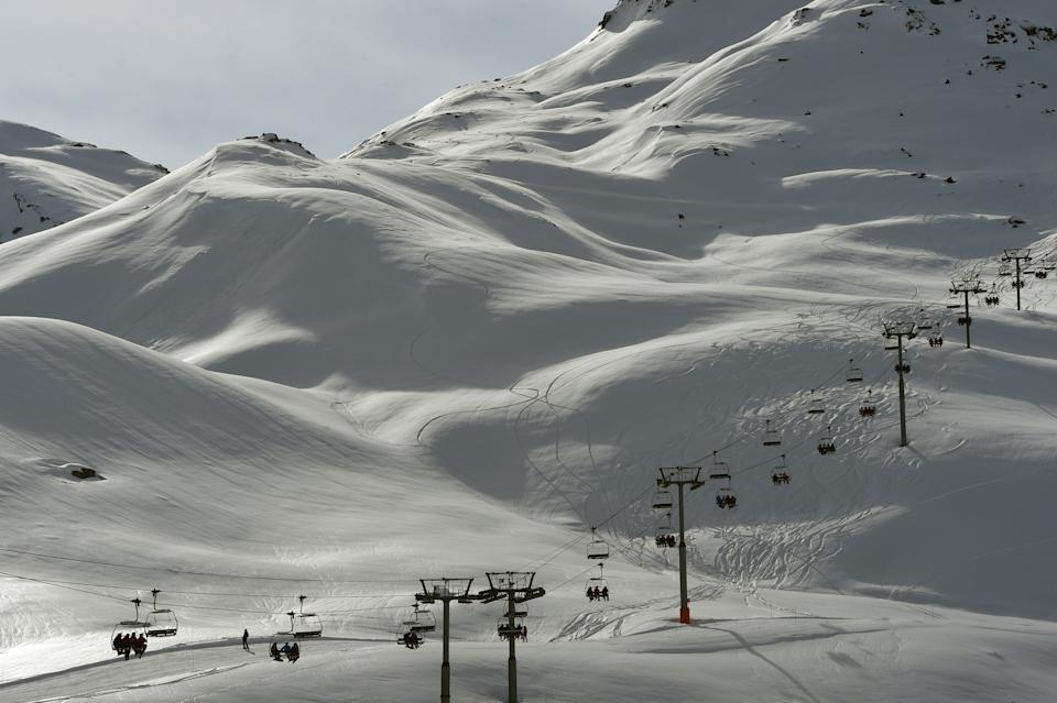 Skiers ride a chairlift on February 2, 2016 in the French ski resort of Meribel in the 3 Valleys ski area, the world's largest ski area, in central French Alps.  French ski resorts prepare for the French winter school holidays' rush that will start on February 6. / AFP / PHILIPPE DESMAZES        (Photo credit should read PHILIPPE DESMAZES/AFP via Getty Images)