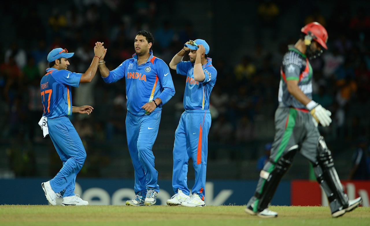 Yuvraj Singh of India celebrates with teammates after dismissing Nawroz Mangal of Afghanistan during the ICC World Twenty20 2012: Group A match between India and Afghanistan at R. Premadasa Stadium on September 19, 2012 in Colombo, Sri Lanka. (Photo by Gareth Copley/Getty Images,)