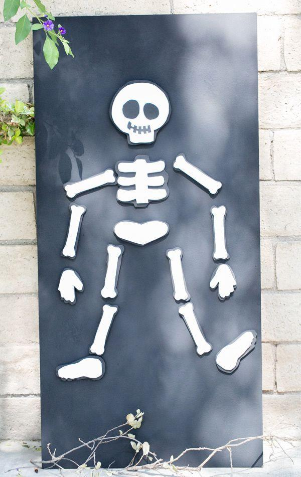 """<p>Make DIY bones out of foam, and hot glue a magnet on each. Coat a board with <a href=""""https://www.amazon.com/Rust-Oleum-277987-247596-Magnetic-Primer/dp/B003ZW7XL4?tag=syn-yahoo-20&ascsubtag=%5Bartid%7C10055.g.2618%5Bsrc%7Cyahoo-us"""" rel=""""nofollow noopener"""" target=""""_blank"""" data-ylk=""""slk:magnetic paint"""" class=""""link rapid-noclick-resp"""">magnetic paint</a> (or just relegate this game to the fridge) and see who can create a skeleton the fastest. </p><p><em><a href=""""http://sugarandcharm.com/2013/10/kids-halloween-party-diy-magnet-board.html/"""" rel=""""nofollow noopener"""" target=""""_blank"""" data-ylk=""""slk:Get the tutorial at Sugar and Charm »"""" class=""""link rapid-noclick-resp"""">Get the tutorial at Sugar and Charm »</a></em> </p>"""
