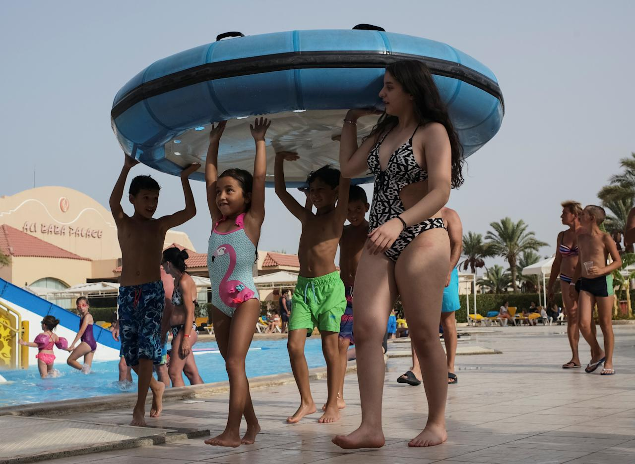 Tourists are seen at a water park in the Red Sea resort of Hurghada, Egypt, July 11, 2017. Picture taken July 11, 2017.  REUTERS/Gleb Garanich