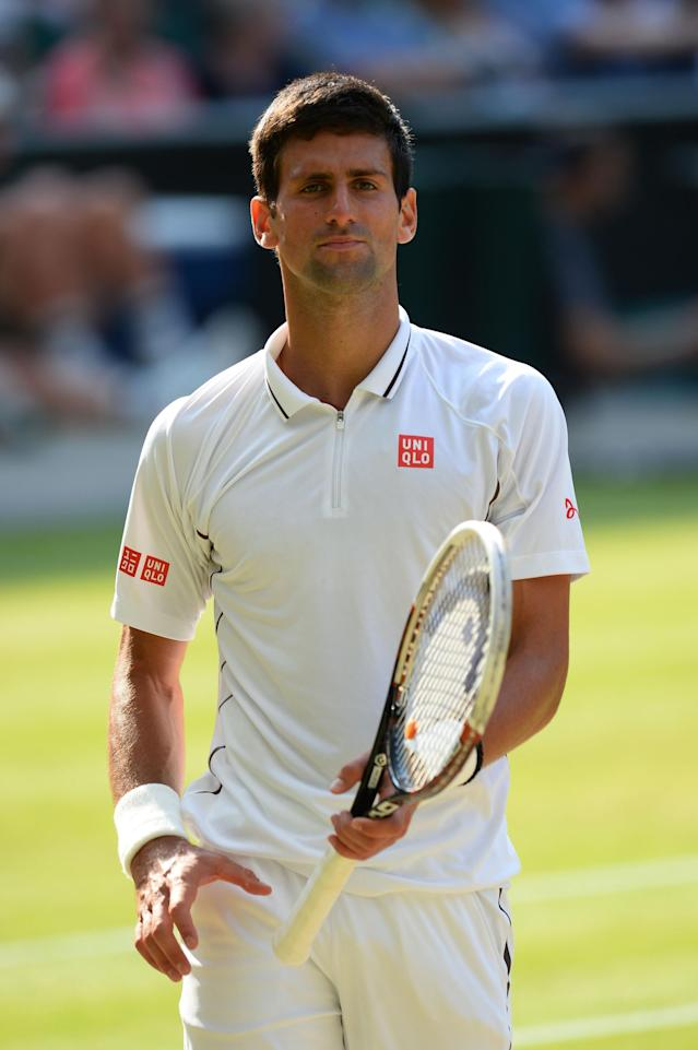 LONDON, ENGLAND - JULY 05: Novak Djokovic of Serbia looks on during the Gentlemen's Singles semi-final match against Juan Martin Del Potro of Argentina on day eleven of the Wimbledon Lawn Tennis Championships at the All England Lawn Tennis and Croquet Club on July 5, 2013 in London, England. (Photo by Mike Hewitt/Getty Images)