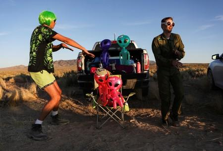 FILE PHOTO: Two men dance on a road to an entrance to Area 51 in Rachel, Nevada
