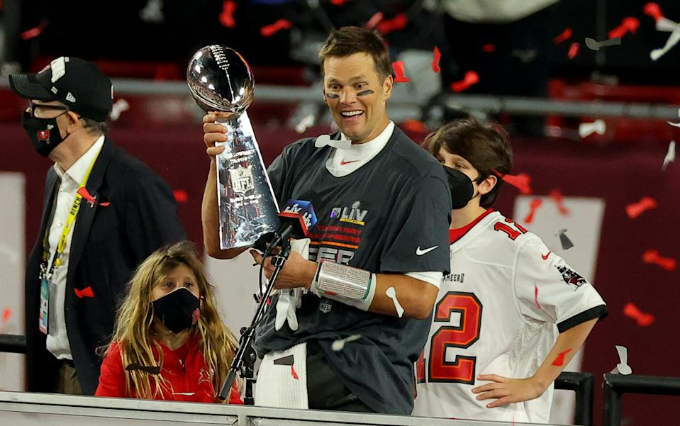 TAMPA, FLORIDA - FEBRUARY 07: Tom Brady #12 of the Tampa Bay Buccaneers hoists the Vince Lombardi trophy after winning Super Bowl LV at Raymond James Stadium on February 07, 2021 in Tampa, Florida. (Photo by Kevin C. Cox/Getty Images)