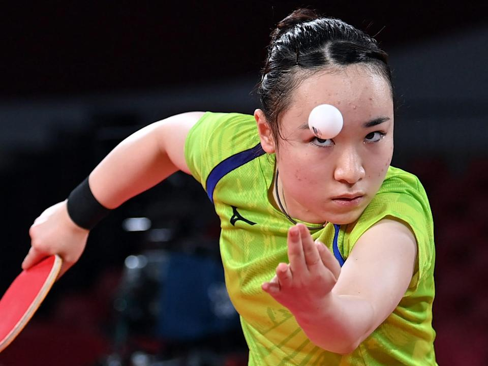 Japan's Mima Ito looks at the bar while serving in ping pong