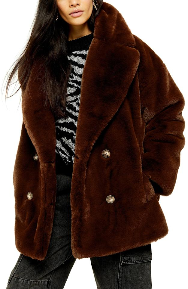 """<p>Stay cozy in this <a href=""""https://www.popsugar.com/buy/Topshop-Ally-Faux-Fur-Double-Breasted-Jacket-520470?p_name=Topshop%20Ally%20Faux%20Fur%20Double%20Breasted%20Jacket&retailer=shop.nordstrom.com&pid=520470&price=140&evar1=fab%3Aus&evar9=43915942&evar98=https%3A%2F%2Fwww.popsugar.com%2Fphoto-gallery%2F43915942%2Fimage%2F46922579%2FTopshop-Ally-Faux-Fur-Double-Breasted-Jacket&list1=shopping%2Cfall%20fashion%2Cfaux%20fur%2Ccoats%2Cfall%2Cjackets%2Cwinter%2Cwinter%20fashion&prop13=api&pdata=1"""" rel=""""nofollow"""" data-shoppable-link=""""1"""" target=""""_blank"""" class=""""ga-track"""" data-ga-category=""""Related"""" data-ga-label=""""https://shop.nordstrom.com/s/topshop-ally-faux-fur-double-breasted-jacket/5425416/full?origin=keywordsearch-personalizedsort&amp;breadcrumb=Home%2FAll%20Results%2FWomen%27s%20Clothing%2FCoats%20%26%20Jackets&amp;color=brown"""" data-ga-action=""""In-Line Links"""">Topshop Ally Faux Fur Double Breasted Jacket</a> ($140).</p>"""