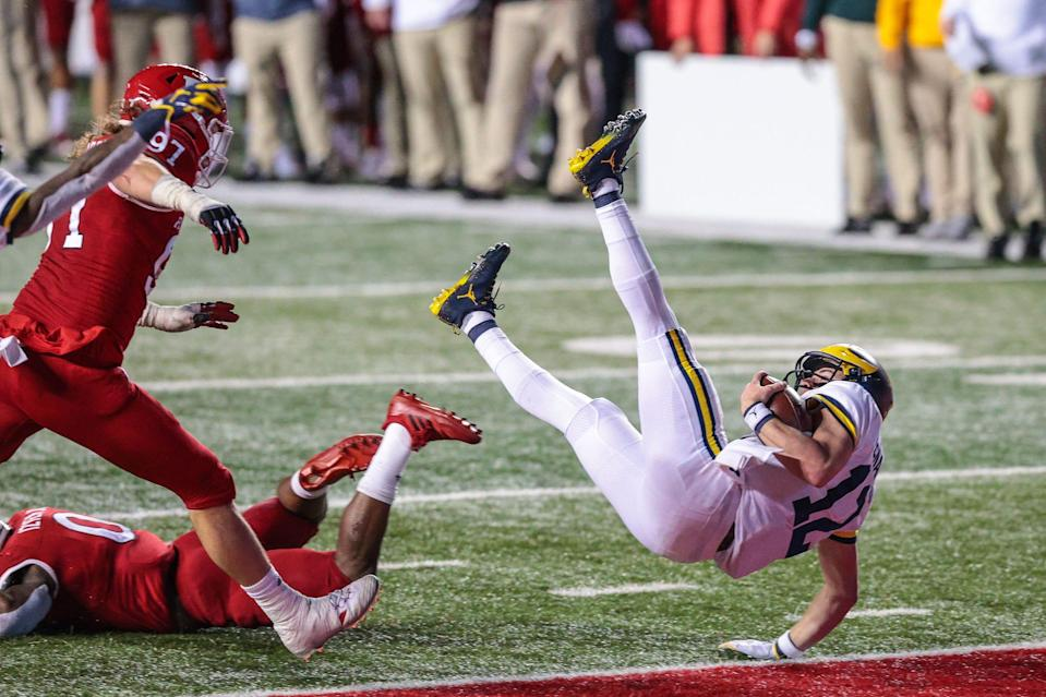 Michigan Wolverines quarterback Cade McNamara (12) rushes for a touchdown during the second overtime against the Rutgers Scarlet Knights at SHI Stadium.