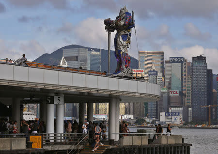 A figure of Transformer is displayed on top of a pier outside the Hong Kong Cultural Centre in Hong Kong