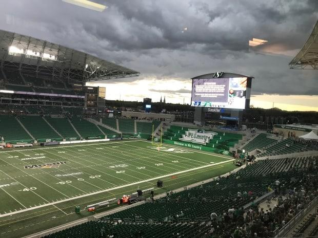 The Saskatchewan Roughriders are one of only two CFL teams not requiring fans to show proof of COVID-19 vaccine or a recent test. Sports business experts say this could hurt the team, and other teams across the province, if they don't change course soon. (Glenn Reid/CBC News - image credit)
