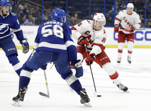 Carolina Hurricanes left wing Jacob Pritchard (36) carries the puck at Tampa Bay Lightning defenseman Ben Thomas (56) during the third period of an NHL preseason hockey game Tuesday, Sept. 17, 2019, in Tampa, Fla. (AP Photo/Chris O'Meara)
