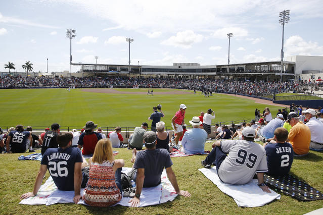 Spring training games continued in Florida Thursday, complete with crowds, even as other major sports leagues such as the NBA shut down over the spread of the coronavirus. MLB is expected to suspend spring training Friday. (Photo by Michael Reaves/Getty Images)