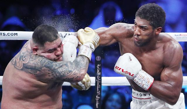 Anthony Joshua lands a punch on Andy Ruiz Jr. during their heavyweight title fight at Diriyah Arena outside Riyadh, Saudi Arabia. (Photo by Valery Sharifulin\TASS via Getty Images)