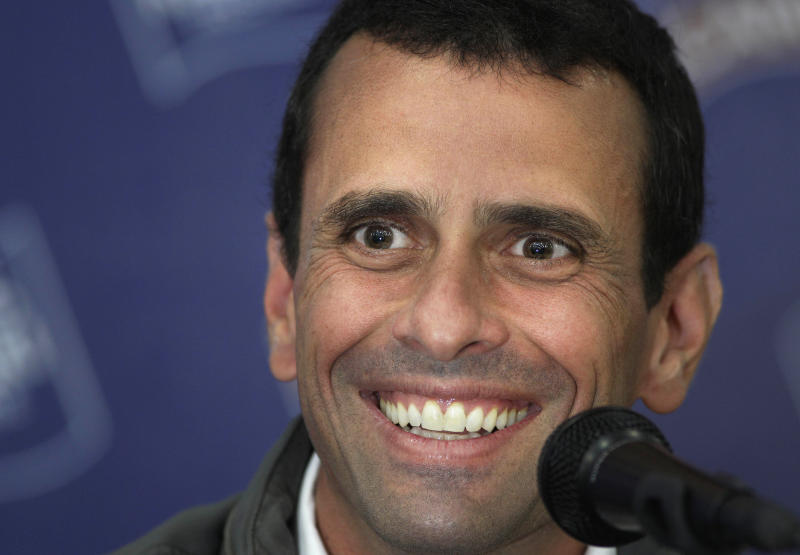 FILE - In this Feb. 13, 2012 file photo, opposition presidential candidate Henrique Capriles smiles during a news conference in Caracas, Venezuela.  Gunshots were fired during an event on Sunday March 4 where Capriles, the leading opponent of President Hugo Chavez, was visiting a traditionally pro-government neighborhood, wounding at least one person and prompting both political camps on Monday to trade blame for the violence. Venezuela will hold presidential elections in October. (AP Photo/Ariana Cubillos, File)