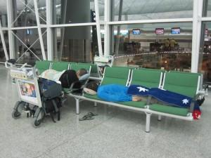 Sleeping on airport benches