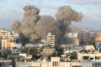 Smoke rises following an Israeli air strike on a building, amid a flare-up of Israeli-Palestinian fighting, in Gaza City