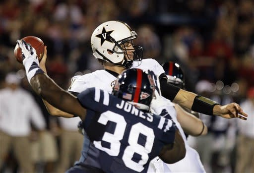 Mississippi defensive end Jason Jones (38) rushes Vanderbilt quarterback Jordan Rodgers (11) into throwing an incomplete pass in the second quarter of an NCAA college football game in Oxford, Miss., Saturday, Nov. 10, 2012. (AP Photo/Rogelio V. Solis)