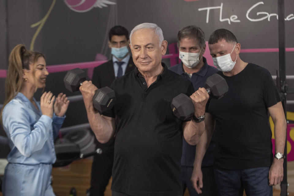 Israeli Prime Minister Benjamin Netanyahu and Health Minister Yuli Edelstein visits Fitness gym ahead of the re-opening of the branch in Petah Tikva, Israel on Saturday, Feb. 20, 2021. (AP Photo/Tal Shahar, Yediot Ahronot, Pool)