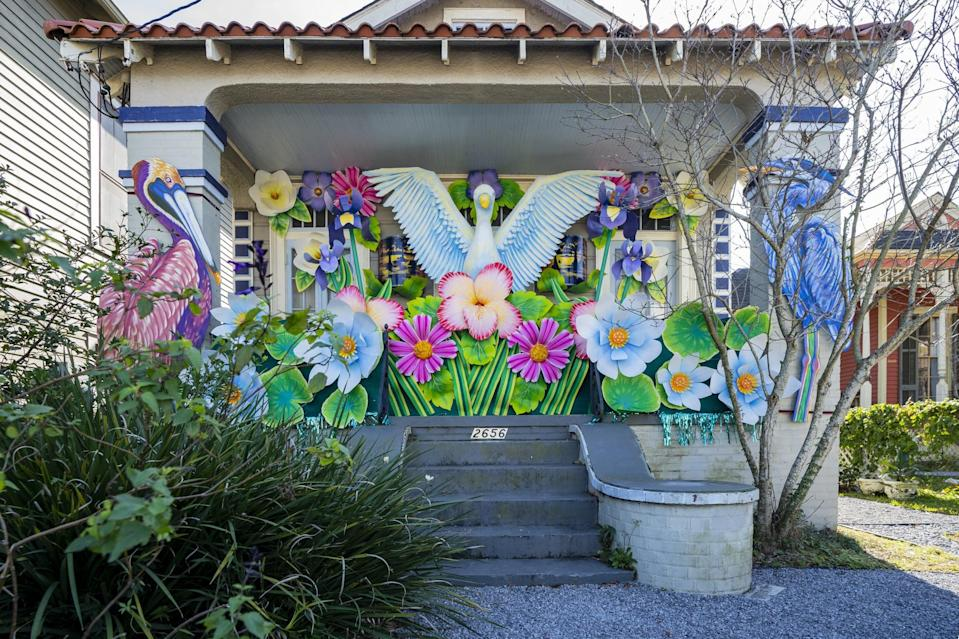 "<p>The Birds of Bulbancha House is another installation of the Krewe of Red Beans house float projects and <a href=""http://www.nola.com/entertainment_life/mardi_gras/article_a27eafa6-5442-11eb-829b-a3111ee32516.html"" class=""link rapid-noclick-resp"" rel=""nofollow noopener"" target=""_blank"" data-ylk=""slk:honors the Choctaw name for the land"">honors the Choctaw name for the land</a>, according to <strong>Nola.com</strong>. The house float on LePage St. can be seen from streets away with it's vibrant color palette and unique designs.</p>"