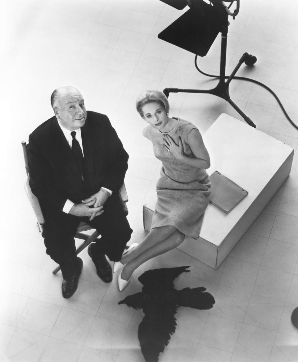Tippi Hedren with British director and producer Alfred Hitchcock on the set of Hitchcock's movie The Birds. (Credit: Universal Pictures/Sunset Boulevard/Corbis via Getty Images)