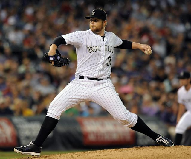 Colorado Rockies starting pitcher Brett Anderson throws in the fifth inning of a baseball game against the Pittsburgh Pirates on Friday, July 25, 2014, in Denver. (AP Photo/Chris Schneider)