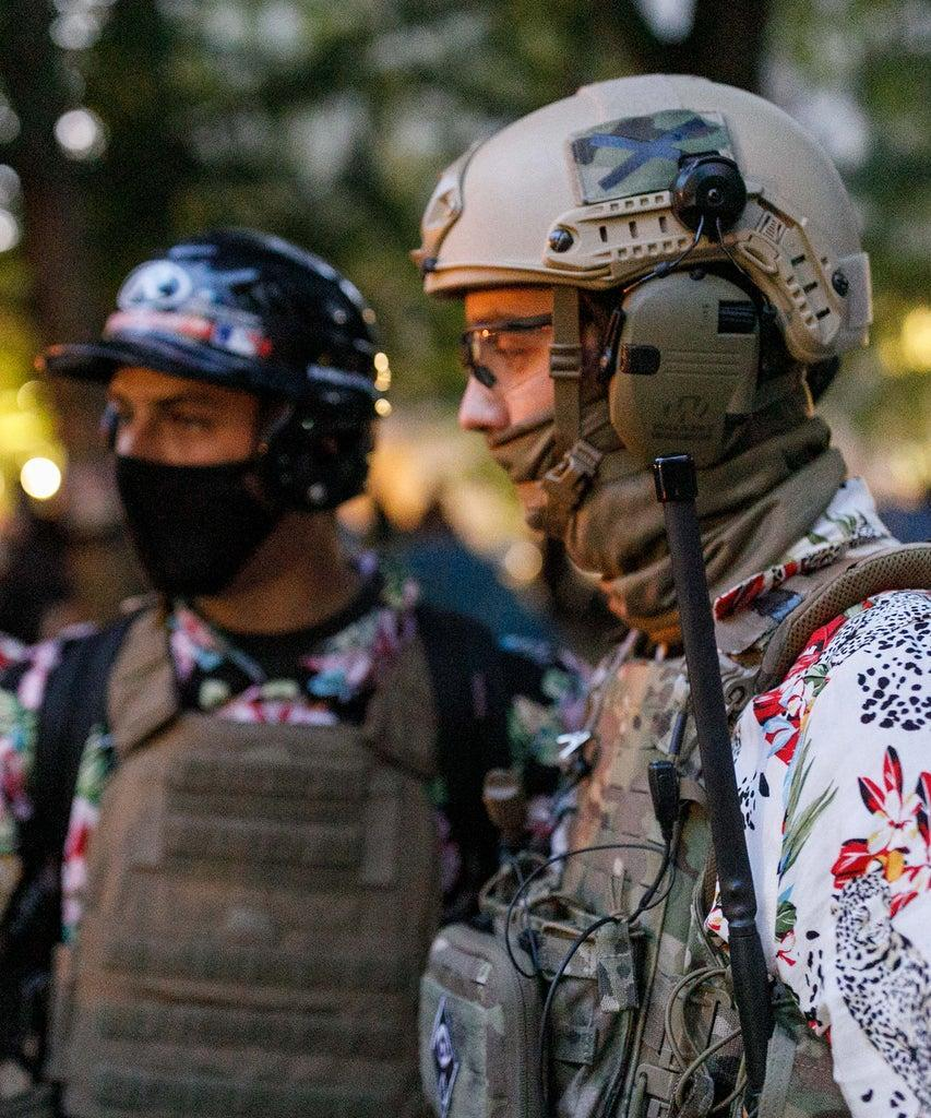 PORTLAND, OREGON, USA – JULY 24: The 'Boogaloo Bois', an armed libertarian group, dress in their signature Hawaiian shirts during a protest on 24, 2020 in Portland, United States. Thousands of people, including mothers, lawyers, health-care workers, and veterans demonstrated in Portland, Oregon on July 24, 2020 for racial justice, and against Donald Trumpâs insertion of Federal officers into Portland, Oregon. (Photo by John Rudoff/Anadolu Agency via Getty Images)