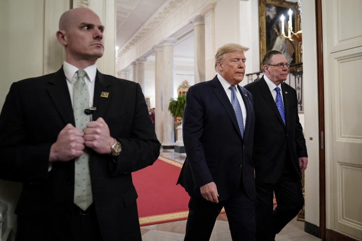 A Secret Service agent stands guard as President Trump and retired Army Gen. Jack Keane arrive at the White House. (Drew Angerer/Getty Images)