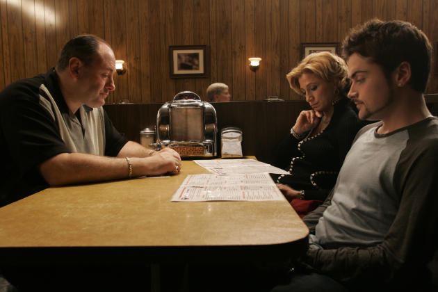 James Gandolfini, as Tony Soprano, left, Robert Iler, as Anthony Soprano Jr., right, and Edie Falco as Carmela Soprano in the last scene of the HBO series, The Sopranos. (AP Photo/HBO, Will Hart, File)