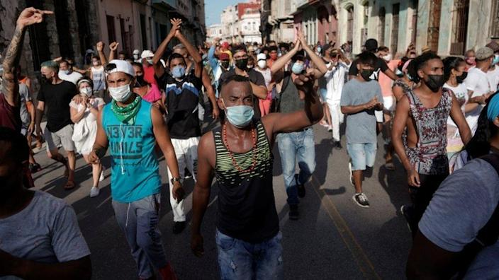 People shout slogans against the government during a protest in Havana