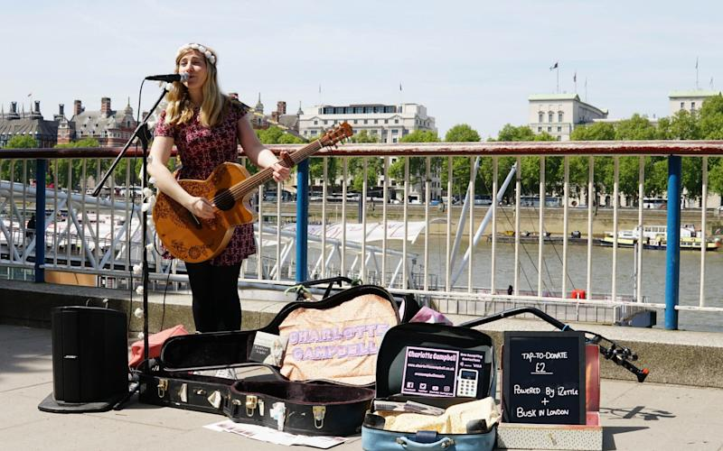 Buskers who entertain the public will be paid by contactless card in the first scheme of its kind in the world - PA