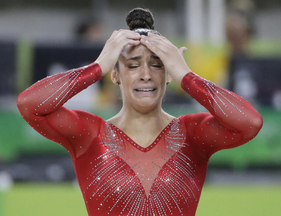Aly Raisman reacts after winning silver in the women's all around. (AP)
